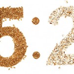 "Image showing grains and rice in the shape of the numbers ""5:2"""