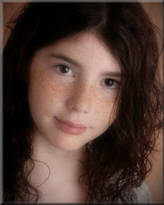 Image of Cassidy Megan - Puple Day founder - young girl with freckles and dark wavy hair