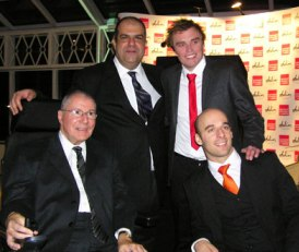 Dr Huw pictured winning the Disabled Entrepreneur of the year award with Stelios and joint winner Rob from ActiveHands.