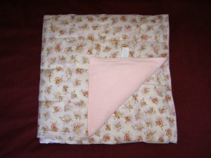 weighted blanket bed covering in pink,looks like a duvet or sheet