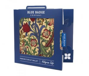 Image is a photograph of a William Morris-inspired blue badge protector in packaging, against a white background