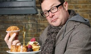 Image of Hugh Fearnley-Whittingstall holding a cake
