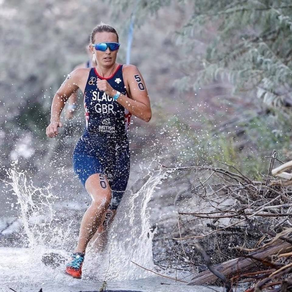 champion triathlete running through the rain with greeper laces