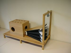 wooden box with a mouthpiece and a bellows that was an early speech machine